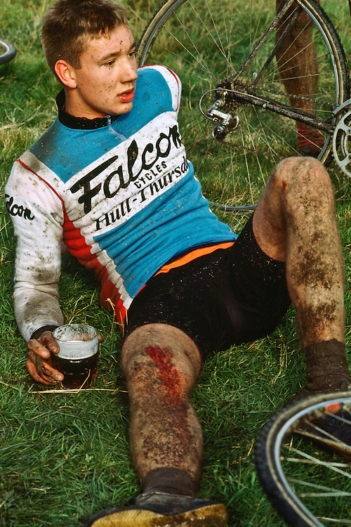 A young bicyclist relaxes after a long race.