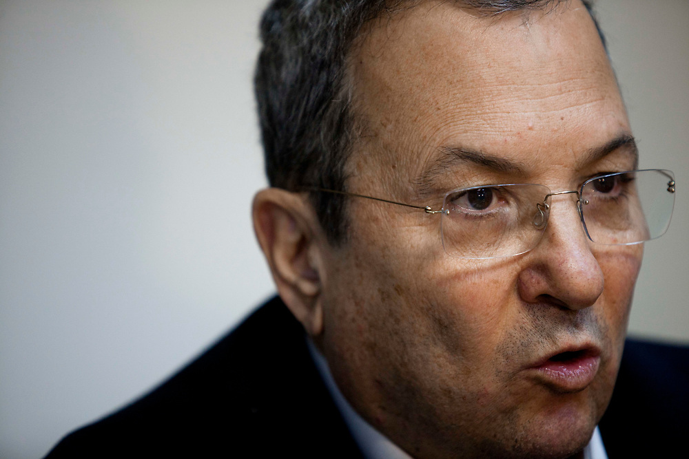 Israel's Defense Minister Ehud Barak speaks during an Atzmaut faction meeting at the Knesset, Israel's parliament in Jerusalem, on January 30, 2012.