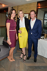 Left to right, PIPPA MIDDLETON, LIZZY PELLY and GUY PELLY at the 3rd birthday party for Spectator Life magazine hosted by Andrew Neil and Olivia Cole held at the Belgraves Hotel, 20 Chesham Place, London on 31st March 2015.