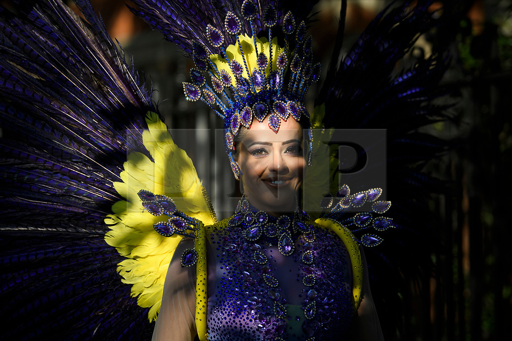 © Licensed to London News Pictures. 26/08/2019. London, UK. A woman in carnival dress enjoying Day two of the Notting Hill carnival. The two day event is the second largest street festival in the world after the Rio Carnival in Brazil, attracting over 1 million people to the streets of West London. Photo credit: Ben Cawthra/LNP