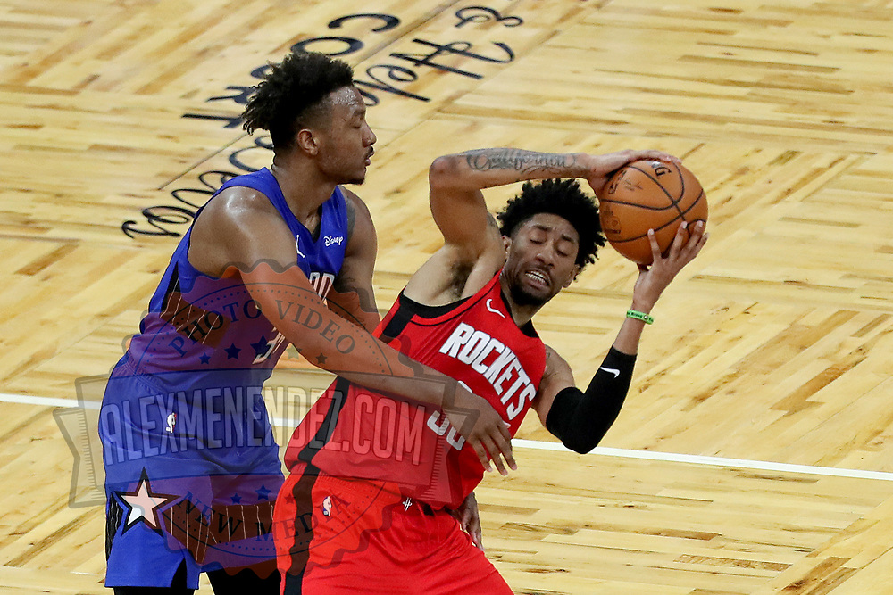 ORLANDO, FL - APRIL 18: Wendell Carter Jr. #34 of the Orlando Magic fouls Christian Wood #35 of the Houston Rockets late in the game at Amway Center on April 18, 2021 in Orlando, Florida. NOTE TO USER: User expressly acknowledges and agrees that, by downloading and or using this photograph, User is consenting to the terms and conditions of the Getty Images License Agreement. (Photo by Alex Menendez/Getty Images)*** Local Caption *** Wendell Carter Jr.; Christian Wood