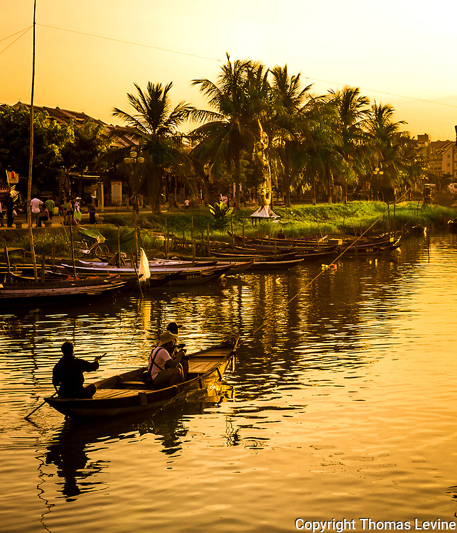 This tourist boat is about to go under a net line on the Thu Bon River in Hoi An.