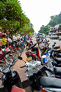 Motor scooters line a street in Luang Prabang, Laos.