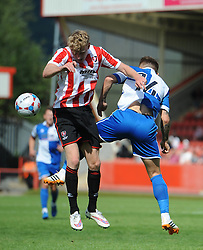 George McLennan of Cheltenham Town challenges for the header with Matty Taylor of Bristol Rovers - Mandatory by-line: Dougie Allward/JMP - 25/07/2015 - SPORT - FOOTBALL - Cheltenham Town,England - Whaddon Road - Cheltenham Town v Bristol Rovers - Pre-Season Friendly