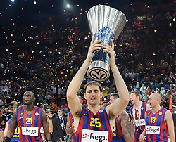 Erazem Lorbek #25 of Regal FC Barcelona celebrates with a Trophy during the 2009-2010 Euroleague Basketball Champion Awards Ceremony at Bercy Arena on May 9, 2010 in Palais Omnisport de Paris Bercy, Paris, France. (Photo by Nebojsa Parausic / Sportida)