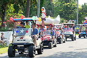 Golf cart floats decorated in tropical style during the annual Independence Day parade July 4, 2019 in Sullivan's Island, South Carolina. The tiny affluent Sea Island beach community across from Charleston holds an outsized golf cart parade featuring more than 75 decorated carts.