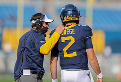 Nov 14, 2020; Morgantown, West Virginia, USA; West Virginia Mountaineers head coach Neal Brown talks with West Virginia Mountaineers quarterback Jarret Doege (2) during the first quarter at Mountaineer Field at Milan Puskar Stadium. Mandatory Credit: Ben Queen-USA TODAY Sports
