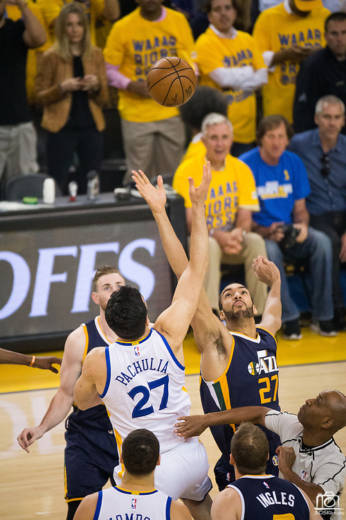 Golden State Warriors center Zaza Pachulia (27) and Utah Jazz center Rudy Gobert (27) battle for the tip-off during Game 2 of the Western Conference Semifinals at Oracle Arena in Oakland, Calif., on May 4, 2017. (Stan Olszewski/Special to S.F. Examiner)