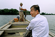 A Japanese businessman takes a ride on the Yagirinowatshi ferry, the last human powered ferry in Tokyo, on the Edogawa river in Shibamata, Tokyo.  Tokyo, Japan. March 2007