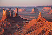 Stagecoach and Bear and Rabbit formations on the left and King on His Throne on the right, looking southeast in Monument Valley