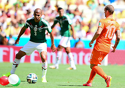 29.06.2014, Castelao, Fortaleza, BRA, FIFA WM, Niederlande vs Mexico, Achtelfinale, im Bild Carlos Salcido (Mexiko) gegen Wesley Sneijder (Niederlande) // during last sixteen match between Netherlands and Mexico of the FIFA Worldcup Brazil 2014 at the Castelao in Fortaleza, Brazil on 2014/06/29. EXPA Pictures © 2014, PhotoCredit: EXPA/ fotogloria/ Best Photo Agency<br /> <br /> *****ATTENTION - for AUT, FRA, POL, SLO, CRO, SRB, BIH, MAZ only*****