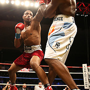 Super Middleweight fighter J'Leon Love (red) fights against Vladine Biosse during Showtime Televisions ShoBox:The Next Generation boxing match at the Event Center at Turning Stone Resort Casino on Friday, February 28, 2014 in Verona, New York.  (AP Photo/Alex Menendez)
