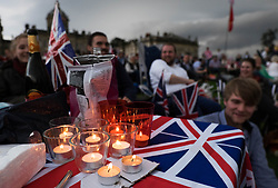 © Licensed to London News Pictures.22/08/15<br /> Castle Howard, North Yorkshire, UK. <br /> <br /> A group of friends sit around a table covered in candles as hundreds of people attend the 25th anniversary of the Castle Howard Proms event near York. The theme of the event this year is a commemoration of the 75th anniversary of the Battle of Britain and the 70th anniversary of VE day and brings an evening of classic musical favourites celebrating Britishness to the lawns of Castle Howard.<br /> <br /> Photo credit : Ian Forsyth/LNP