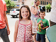 HOT SPRINGS, AR – JUNE 29, 2013: Aspen Ramey (center) holds a water bottle filled with warm spring water near historic Bathhouse Row.