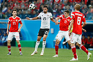 Egypt Trezeguet (C) and Russia Aleksandr Golovin (L) and Russia Roman Zobnin (R) during the 2018 FIFA World Cup Russia, Group A football match between Russia and Egypt on June 19, 2018 at Saint Petersburg Stadium in Saint Petersburg, Russia - Photo Stanley Gontha / Pro Shots / ProSportsImages / DPPI