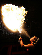 """""""Miss Fire"""" spews a fire ball during a release party for the last of the series Harry Potter book at King's books in Tacoma, WA. (Photo/John Froschauer)"""