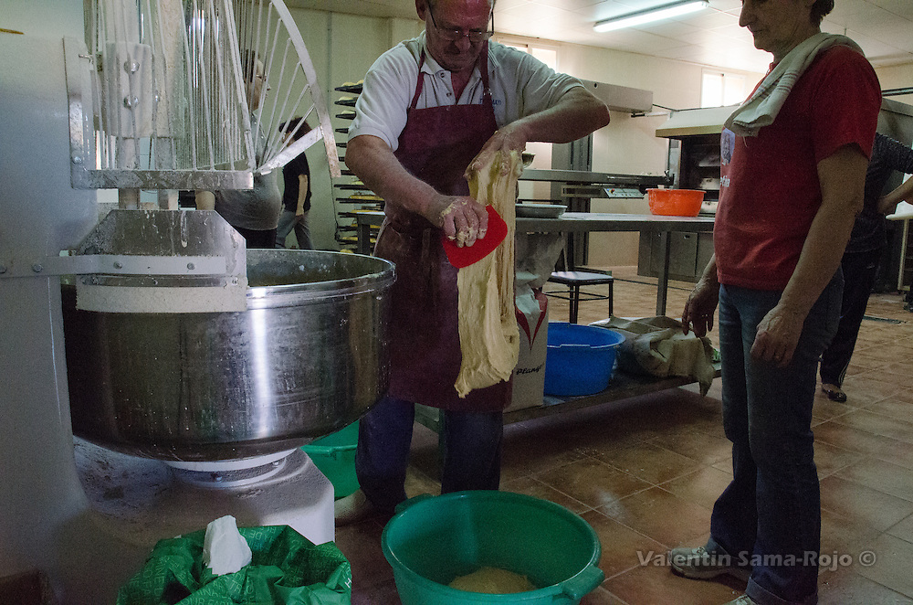 The baker cuts the dough and put it on big buckets and leave it two hours for fermentation.