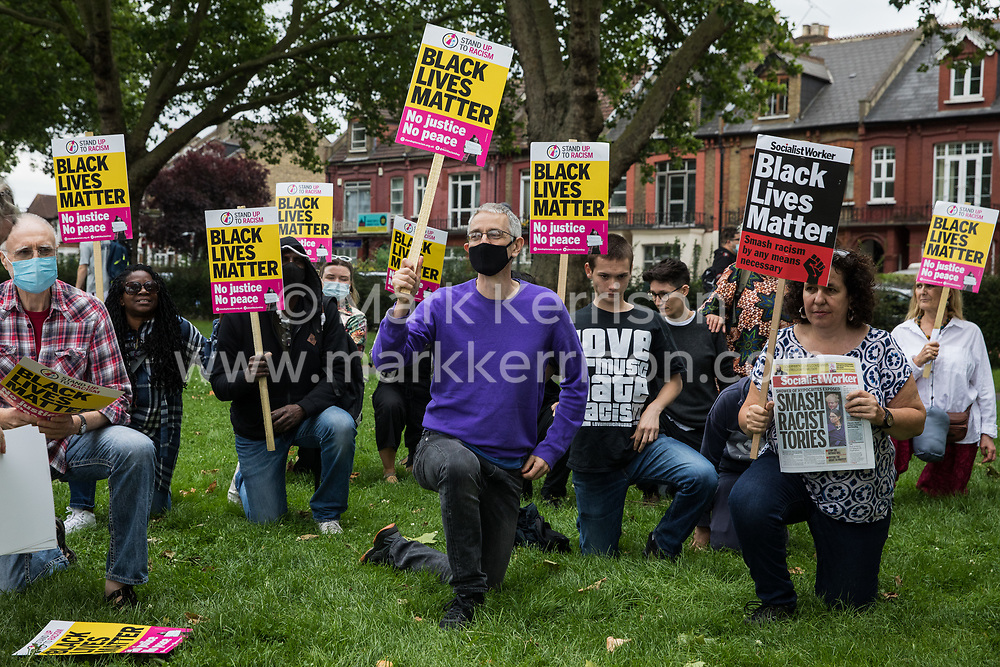 Anti-racist campaigners take a knee in solidarity with England footballers Marcus Rashford, Jadon Sancho and Bukayo Saka during an event on Ducketts Common organised by Haringey Stand Up To Racism on 15th July 2021 in London, United Kingdom. The three England footballers were subjected to racial abuse following England's Euro 2020 final defeat against Italy.
