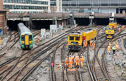 © Licensed to London News Pictures. 09/07/2019. London, UK. An engineering train (R) sits across the tracks outside Victoria railway station after becoming derailed at 3am. Thousands of rail passengers have been affected with disruption to services expected to last all day. Photo credit: Peter Macdiarmid/LNP