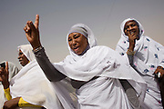 Darfurian women express the hope of peace when they line-up at Al Fashir airport, Sudan to greet British peer Lord Ahmed of Rotheram who has brought over from the UK, a delegation to attend the first-ever international Conference on Womens' Challenge in Darfur, hosted by the govenor in his own compound.