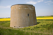 Martello tower in marshes converted to house, Bawdsey, Suffolk, England