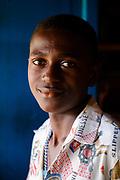 Portrait of a boy inside a restaurant in Santo António do Príncipe, the tiny capital of Príncipe island