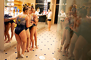 Abby Heiskell, Natalie Wojcik, Abby Brenner, and Maddie Mariani of the Michigan Wolverines pose for a photo in the locker room before their meet against Iowa at the Crisler Center on February 10, 2019 in Ann Arbor, Michigan.