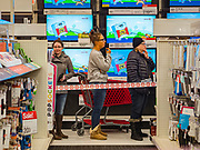 """28 NOVEMBER 2019 - ANKENY, IOWA: Shoppers in line in the electronics department at the Target store in Ankeny, Iowa. """"Black Friday"""" is the unofficial start of the Christmas holiday shopping season and has traditionally thought to be one of the busiest shopping days of the year. Brick and mortar retailers, like Target, are facing increased pressure from online retailers this year. Many retailers have started opening on Thanksgiving Day. Target stores across the country opened at 5PM on Thanksgiving to attract shoppers with early """"Black Friday"""" specials.  PHOTO BY JACK KURTZ"""