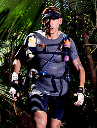 """© Licensed to London News Pictures. 11/10/2013. BRAZIL. Athlete running through dense amazon jungle. Competitors take part in the Jungle Marathon 2013, the """"The toughest ultra marathon in the world"""" The race is 245 km long through the biggest jungle in the world, The Amazon. It attracts competitors from all countries world wide. Competitors run through territories of indigenous tribes throughout the 7 day race, where they stay with them as guests.. Photo credit : Alexander Beer/LNP"""