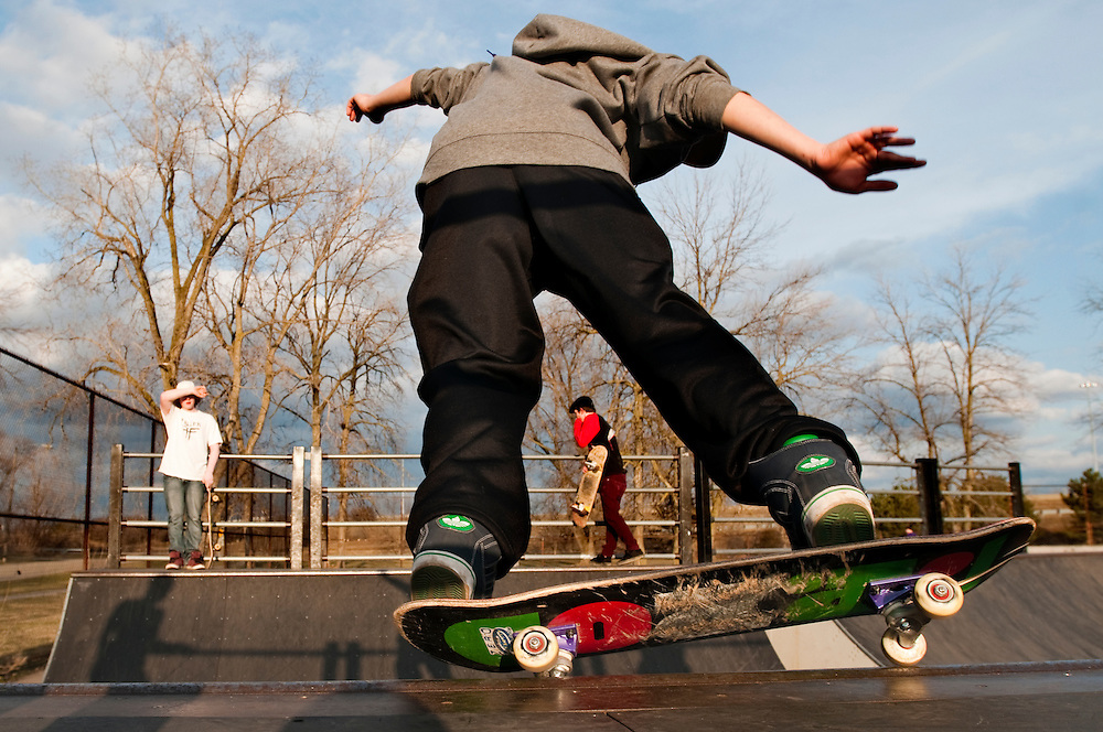 Matt Dixon | The Flint Journal..Kids get out a skate in the warm weather Friday evening at the skate park in Flint.