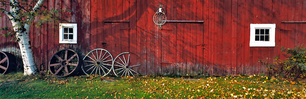Autumn color enhances the deep red siding of an old barn near Franconia Notch, New Hampshire.