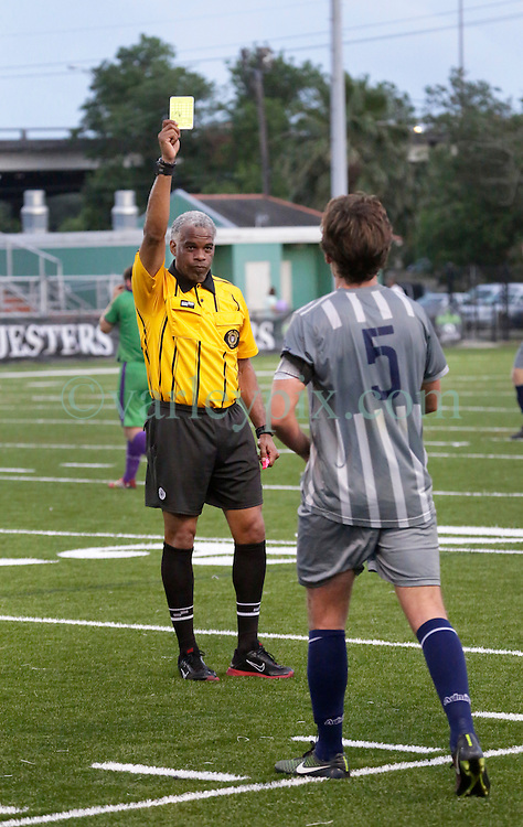 16 May 2015. New Orleans, Louisiana.<br /> National Premier Soccer League. NPSL. <br /> 1st half. The New Orleans Jesters play Nashville FC at home in the Pan American Stadium. First of the yellow cards. Jesters drew 1-1 with Nashville in a game that ended in a controversial equalizer from a free kick awarded to Nashville as the minutes wound down in extra time.<br /> Photo; Charlie Varley/varleypix.com