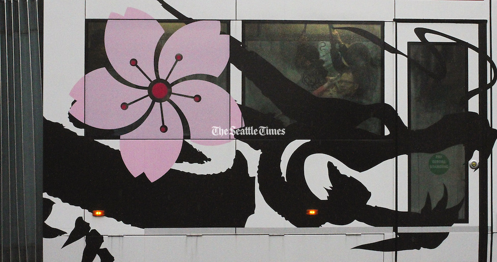 The cherry blossom artwork on this First Hill Streetcar references Seattle's Nihonmachi, or Japantown, that thrived in the decades before World War II. (Alan Berner/The Seattle Times)