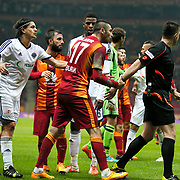 Referee's Huseyin Gocek (R) and Galatasaray's Burak Yilmaz (C) during their Turkish Super League soccer match Galatasaray between Kasimpasaspor at the TT Arena at Seyrantepe in Istanbul Turkey on Friday, 31 October 2014. Photo by Kurtulus YILMAZ/TURKPIX
