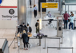"© Licensed to London News Pictures. 09/04/2021. London, UK. Passengers queue up at a testing centre at at London Heathrow. Today, Transport Secretary Grant Shapps sets out details of the government's ""traffic Light"" system for May 17th so that the public can travel abroad with passengers requiring to take a private covid-19 test each way, costing as much as £150.00 for one test. Photo credit: Alex Lentati/LNP"