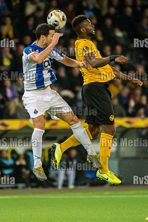 BERN, SWITZERLAND - NOVEMBER 28: #15 Mamadou Ndiyae of FC Porto battles for the ball with #18 Jean-Pierre Nsame of BSC Young Boys during the UEFA Europa League group G match between BSC Young Boys and FC Porto at Stade de Suisse, Wankdorf on November 28, 2019 in Bern, Switzerland. (Photo by Robert Hradil/RvS.Media)