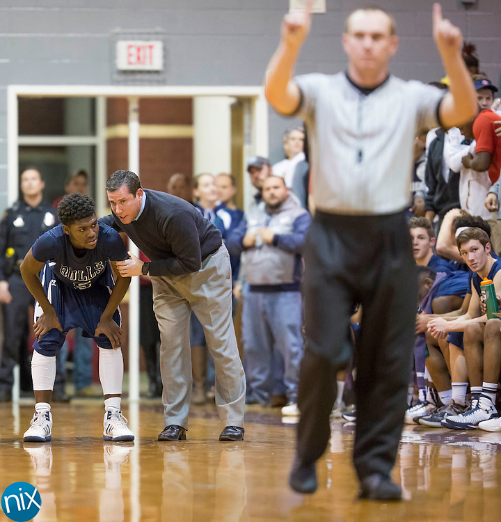 Hickory Ridge head coach Robert Machado, right, talks to Javon Smith while facing JM Robinson during a 3A west state basketball playoff game Thursday, February 25, 2016 at Jay M Robinson High School in Concord, NC. Photo by JASON E. MICZEK - www.miczekphoto.com