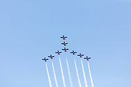 Canadian Forces Snowbirds in the Canada Goose formation with smoke.  The Snowbirds are also known as the 431 Air Demonstration Squadron and fly the Canadair CT-114 Tutor jet. Photographed during the Canada 150 celebrations in White Rock, British Columbia, Canada.