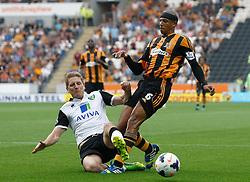 Norwich City's Michael Turner tackles Hull City's Curtis Davies   - Photo mandatory by-line: Matt Bunn/JMP - Tel: Mobile: 07966 386802 24/08/2013 - SPORT - FOOTBALL - KC Stadium - Hull -  Hull City V Norwich City - Barclays Premier League