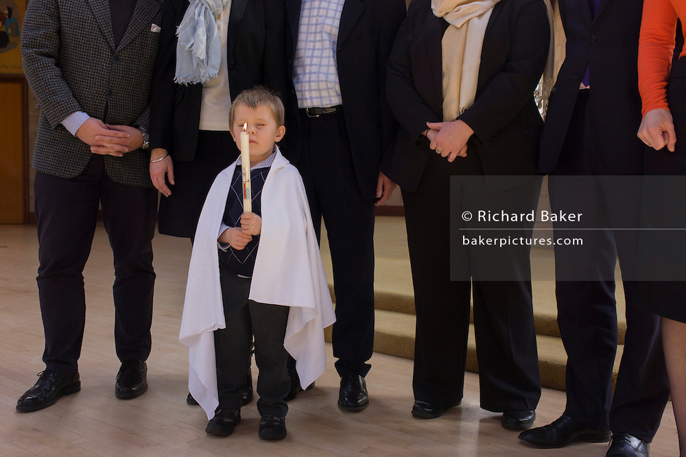 Family and relatives after a 4 year-old's baptism ceremony in a local Catholic church