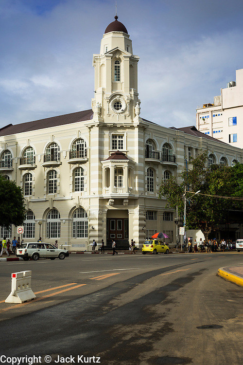07 JUNE 2014 - YANGON, MYANMAR: A renovated colonial era building in downtown Yangon. The building now houses tourist shops and cafes. Yangon has the highest concentration of colonial style buildings still standing in Asia. Efforts are being made to preserve the buildings but many are in poor condition and not salvageable.    PHOTO BY JACK KURTZ