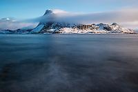 Offersøykammen mountain peak rises from turbulent waters of Nappstraumen, Lofoten Islands, Norway
