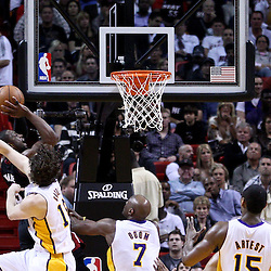 March 10, 2011; Miami, FL, USA; Miami Heat shooting guard Dwyane Wade (3) shoots over Los Angeles Lakers power forward Pau Gasol (16) during the first quarter at the American Airlines Arena.  Mandatory Credit: Derick E. Hingle