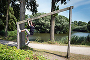Merelbeke, 7 jul 2017,Boy playing at the liedemeerspark along the river scheldt