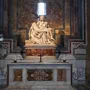 """Michelangelo's classic """"Pieta"""" greets visitors upon arrival inside St Peter's Basilica, or Basilica di San Pietro, at The Vatican. Created in his 20s, it epitomizes the artist's talent at an early age."""