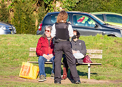 """© Licensed to London News Pictures. 27/02/2021. London, UK. Police move on members of the public as they enjoy the sunshine and mild temperatures on Wimbledon Common, South West London as officers enforce Covid-19 rules. This week, Prime Minister Boris Jonson announced his """"Roadmap Map' out of Lockdown with a gradual unlocking of Covid-19 restrictions over the next few months. Photo credit: Alex Lentati/LNP"""