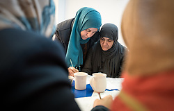 17 February 2020, Zarqa, Jordan: Incentive-Based Volunteer Sana'a Sana'a gives instructions a a group of women draw up their designs during ceramics class held by the Lutheran World Federation at the Zarqa Ladies Association, one of some 200 Community-Based Organizations in Zarqa. Through a variety of activities, the Lutheran World Federation serves to offer psychosocial support and strengthen social cohesion between Syrian, Iraqi and other refugees in Jordan and their host communities.