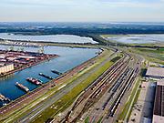 Nederland, Zuid-Holland, Rotterdam, 14-09-2019; Tweede Maasvlakte (MV2),  Hartelhaven (voorgrond), Mississippihaven met EMO (overslag droge bulk, zoals erts en kolen). Aan de Europaweg emplacementMaasvlakte van ProRail.<br /> Second Maasvlakte (MV2), Maasvlakte Plaza. Mississippihaven with EMO (transshipment of dry bulk, such as ore and coal). On the Maasvlakte Europaweg yard of ProRail.<br /> <br /> luchtfoto (toeslag op standard tarieven);<br /> aerial photo (additional fee required);<br /> copyright foto/photo Siebe Swart