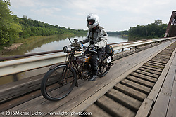 Norm Nelson riding his 1911 single-cylinder, single-speed, belt drive Class-1 Reading Standard motorcycle over the treacherous to motorcycles wooden Wabash Cannonball Bridge in St. Francisville, Illinois during the Motorcycle Cannonball Race of the Century. Day-4 ride from Bloomington, IN to Cape Girardeau, MO. USA. Wednesday September 14, 2016. Photography ©2016 Michael Lichter.