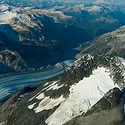Iliamna volcano, Chigmit Mountains and icefields rise sharply above Lake Clark National Park, Alaska
